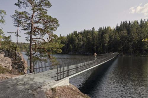 Visionsbild av bron, sett från Alby. Illustration av Gottlieb Paludan Architects.